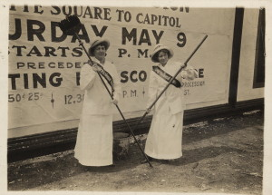 Members of the Congressional Union for Woman Suffrage paste advertisements announcing a march to the capitol in 1914. Courtesy of the Library of Congress.